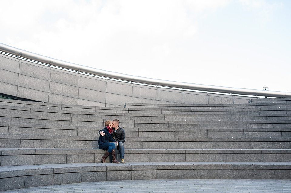 Couple engagement shoot sitting on steps at Southbank London Fiona Kelly wedding photographer