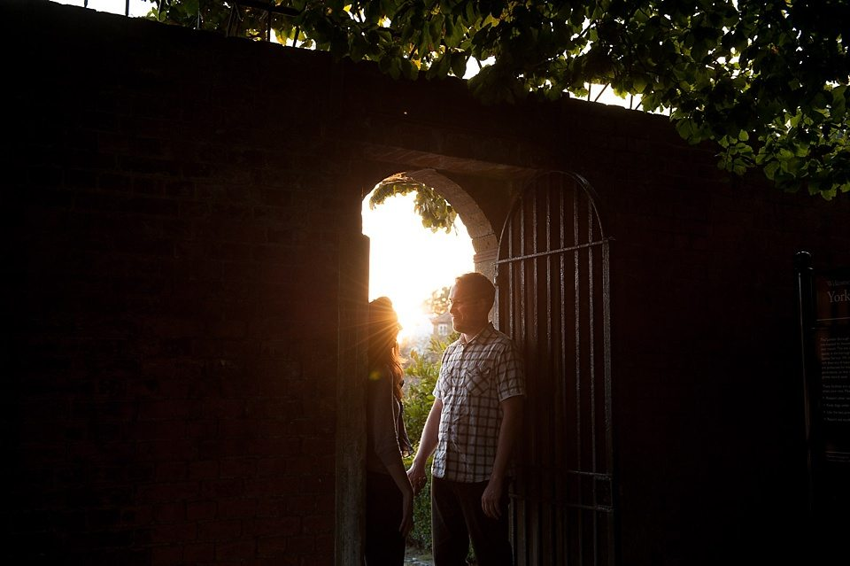 Couple love engagement shoot in golden hour evening light Fiona Kelly wedding photographer