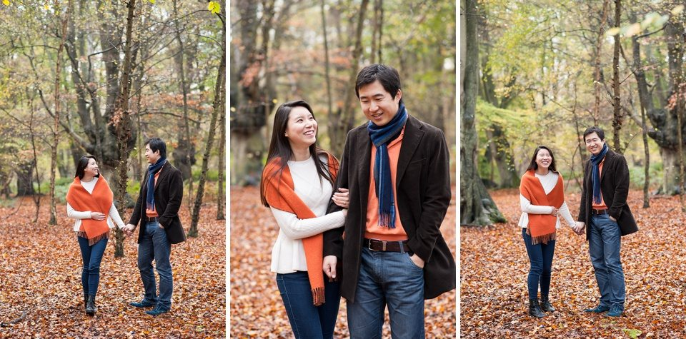 couple walking, laughing, holding hands amongst the trees - Couple love shoot - Autumn engagement shoot - Epping Forest in London, Essex in England © Fiona Kelly wedding photographer