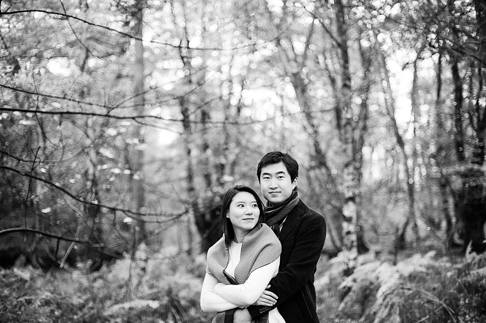 Black and white couple love shoot - Autumn engagement shoot - Epping Forest in London, Essex in England © Fiona Kelly wedding photographer