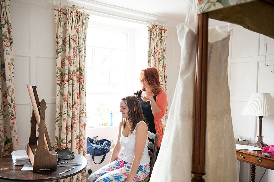 Getting ready for wedding at Spread Eagle hotel - wedding accommodation for english country garden wedding Sussex wedding photographer © Fiona Kelly photography