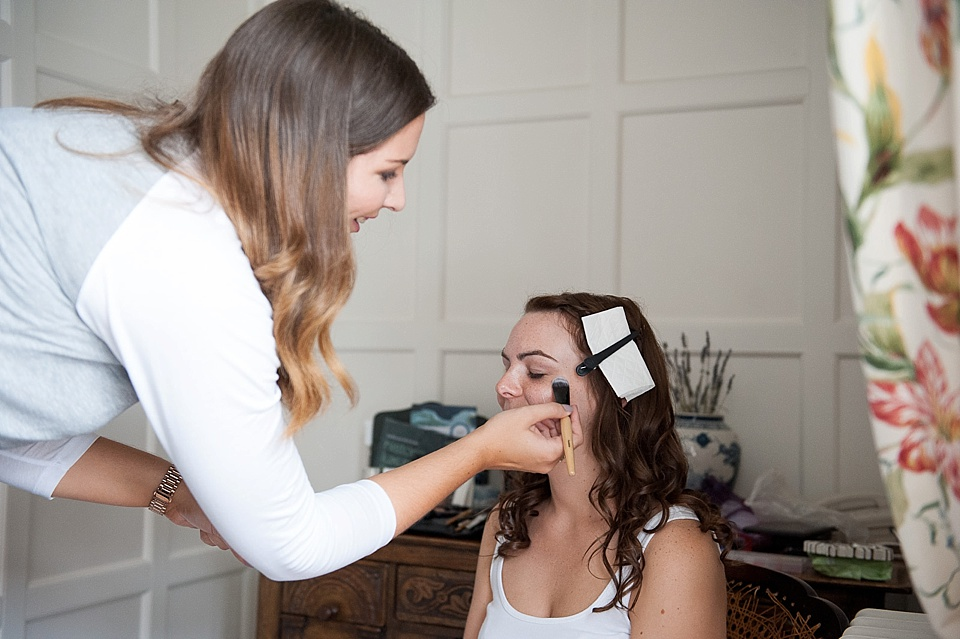 Kat Priest makeup artist doing bridal prep - - English country garden wedding at the Walled Garden at Cowdray - Sussex wedding photographer © Fiona Kelly photography