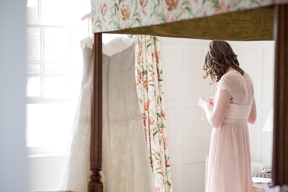 Bridesmaid in dusky pink Kaliko dress getting ready - English country garden wedding at the Walled Garden at Cowdray - Sussex wedding photographer © Fiona Kelly photography