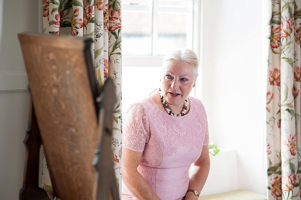 Mother of the bride in pink getting ready - English country garden wedding at the Walled Garden at Cowdray - Sussex wedding photographer © Fiona Kelly photography