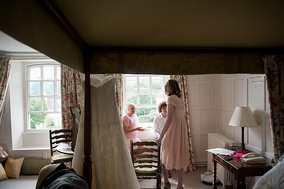 Bridesmaid, bridesman and mother of the bride in pink getting ready - English country garden wedding at the Walled Garden at Cowdray - Sussex wedding photographer © Fiona Kelly photography