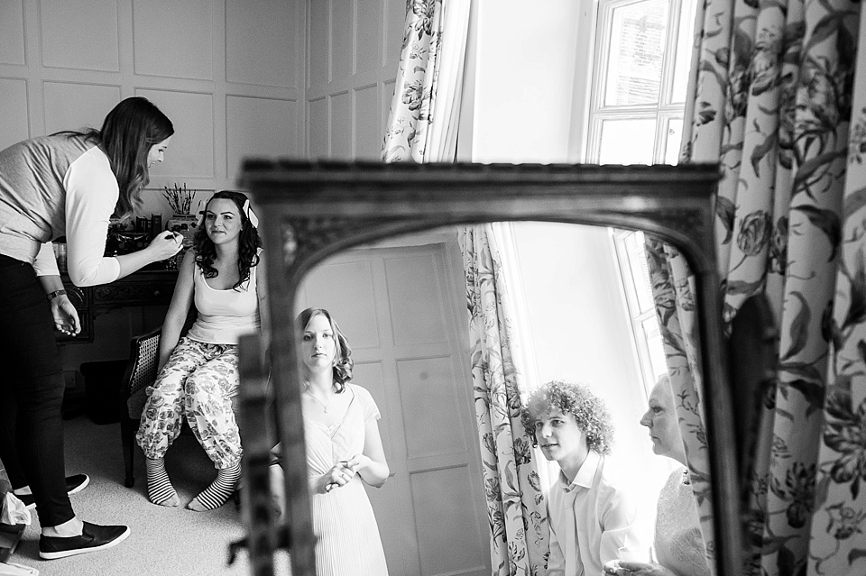 Reflection in the mirror during bridal prep in black and white - English country garden wedding at the Walled Garden at Cowdray - Sussex wedding photographer © Fiona Kelly photography
