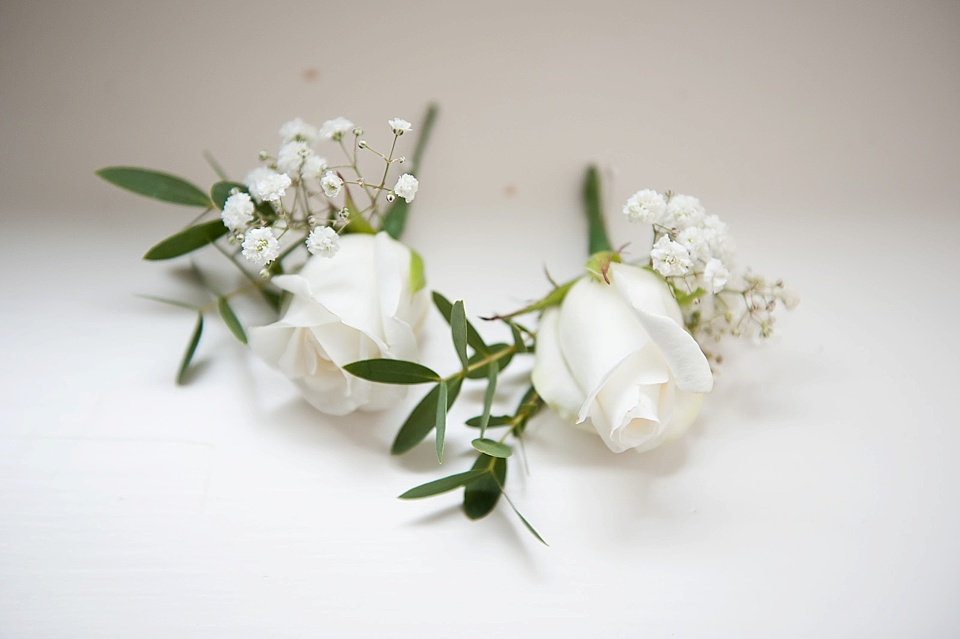 Delicate white roses by Blooms - English country garden wedding at the Walled Garden at Cowdray - Sussex wedding photographer © Fiona Kelly photography
