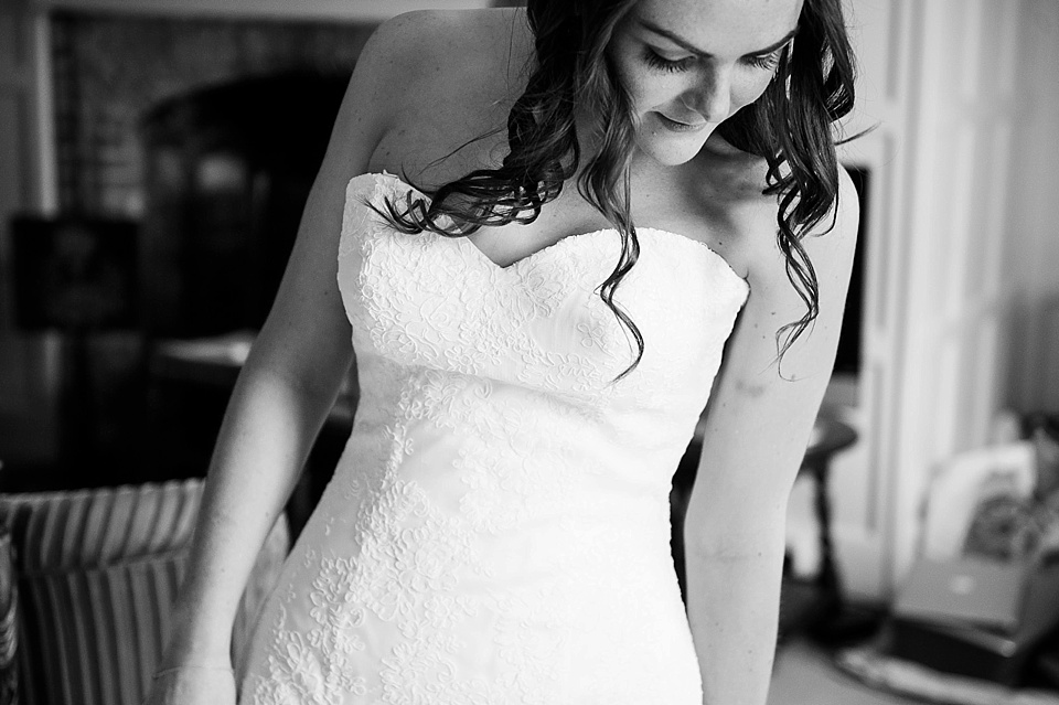 Bride in simple delicate lace Lillian West wedding dress - English country garden wedding at the Walled Garden at Cowdray - Sussex wedding photographer © Fiona Kelly photography