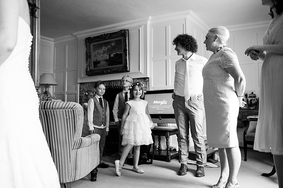 Flower girl and pageboys at the Spreaded Eagle Hotel - English country garden wedding at the Walled Garden at Cowdray - Sussex wedding photographer © Fiona Kelly photography