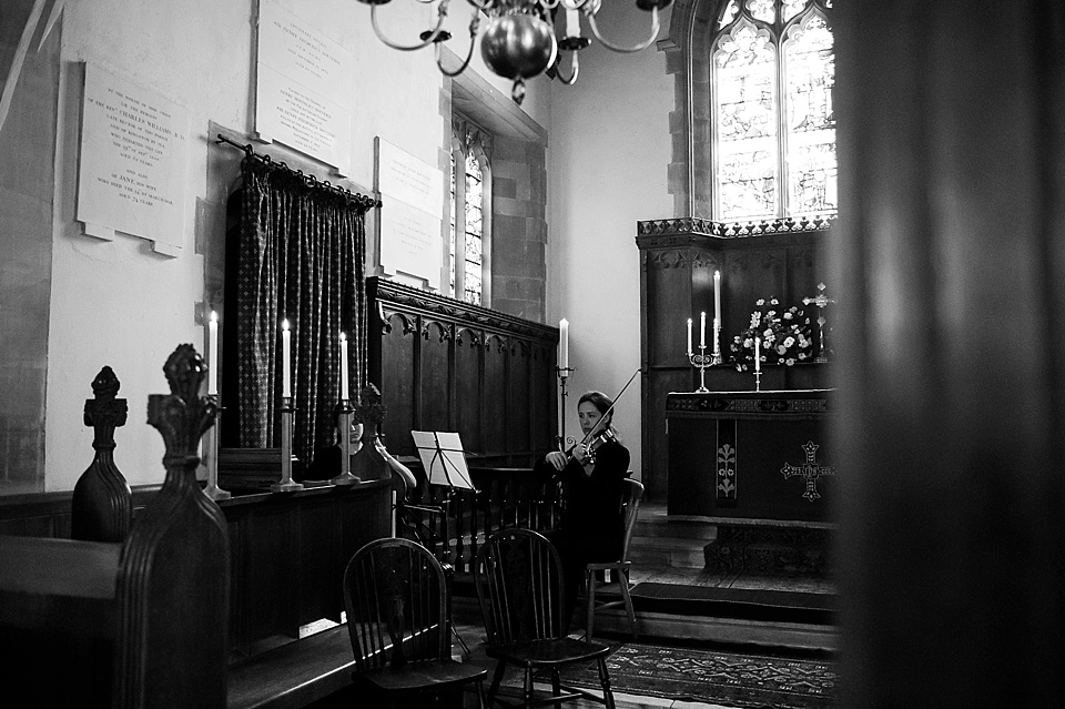 Violinist playing in church for wedding - English country garden wedding All Hallows Church Woolbeding Sussex wedding photographer © Fiona Kelly photography