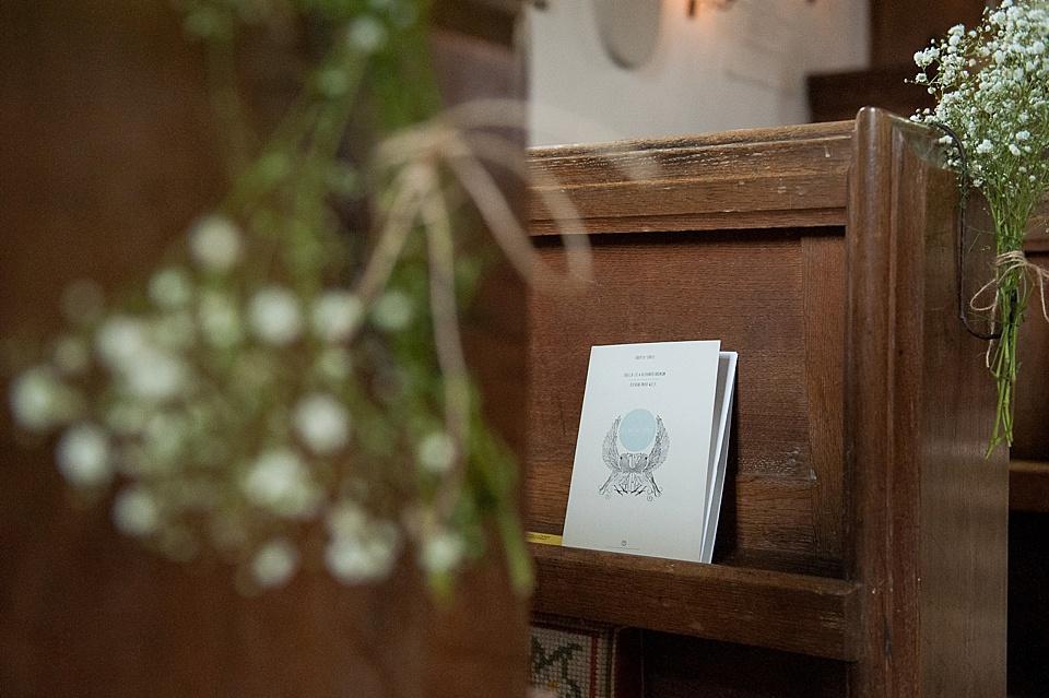 DIY order of service with gysophilia decor - English country garden wedding All Hallows Church Woolbeding church pew with babies breath gysophilia