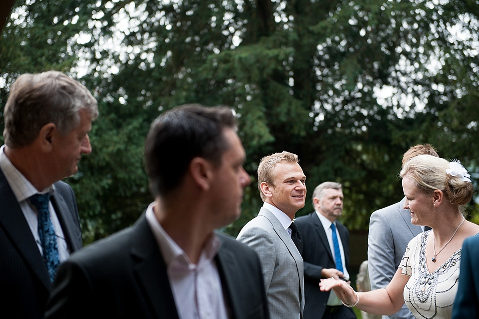 Groom arrives with guests - English country garden wedding All Hallows Church Woolbeding Sussex wedding photographer © Fiona Kelly photography