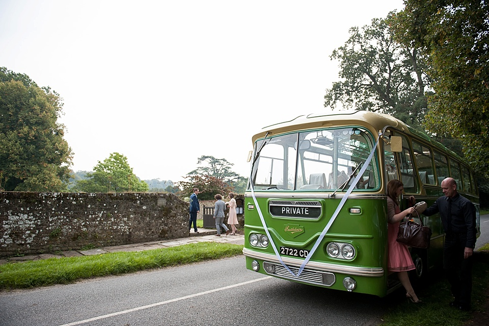 Vintage green bus like Audrey Hepburn chocolate advert - English country garden wedding All Hallows Church Woolbeding Sussex wedding photographer © Fiona Kelly photography