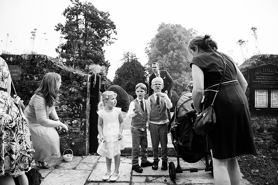 Flower girls and pageboys at English country garden wedding All Hallows Church Woolbeding Sussex wedding photographer © Fiona Kelly photography
