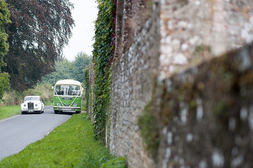 Vintage green bus and vintage white car for English country garden wedding All Hallows Church Woolbeding Sussex wedding photographer © Fiona Kelly photography