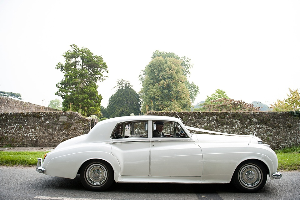 Vintage white car from First Choice Wedding Cars at English country garden wedding All Hallows Church Woolbeding Sussex wedding photographer © Fiona Kelly photography