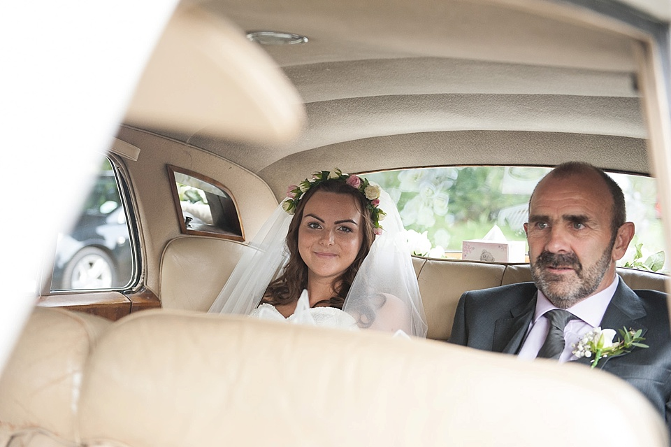 Natural bride with flower crown and father in vintage car - English country garden wedding All Hallows Church Woolbeding Sussex wedding photographer © Fiona Kelly photography