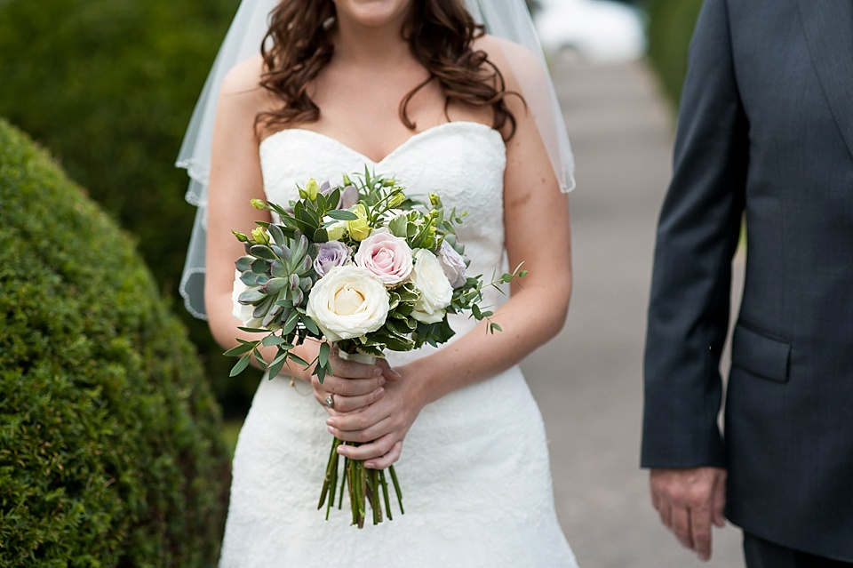 Lillian West lace wedding dress and pink rose bouquet with succulents by Blooms - English country garden wedding All Hallows Church Woolbeding Sussex wedding photographer © Fiona Kelly photography