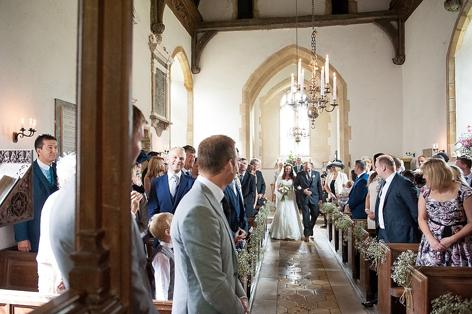 groom watches bride walk down the aisle - English country garden wedding All Hallows Church Woolbeding Sussex wedding photographer © Fiona Kelly photography
