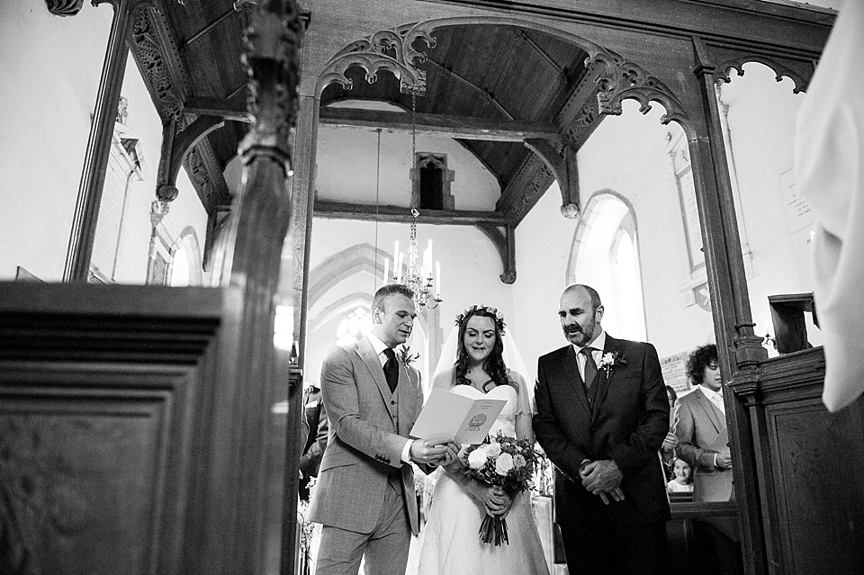 Bride, groom and father of the bride sing - English country garden wedding All Hallows Church Woolbeding Sussex wedding photographer © Fiona Kelly photography