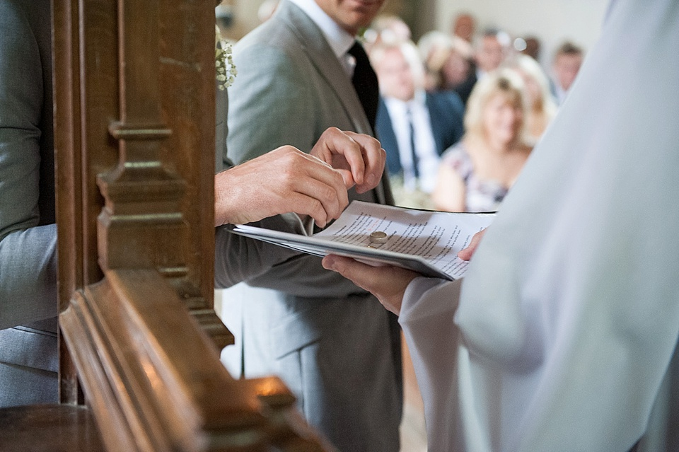 The exchange of the rings - English country garden wedding All Hallows Church Woolbeding Sussex - natural wedding photographer © Fiona Kelly photography