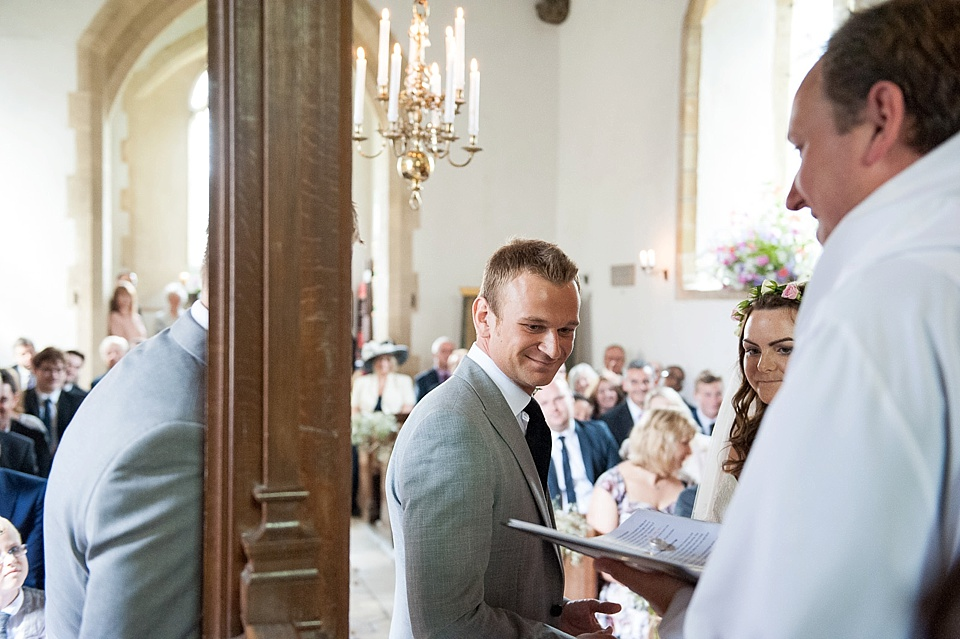 The wedding ceremony - English country garden wedding All Hallows Church Woolbeding Sussex - natural wedding photographer © Fiona Kelly photography