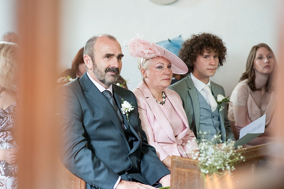 Bride's family watch - English country garden wedding All Hallows Church Woolbeding Sussex - natural wedding photographer © Fiona Kelly photography