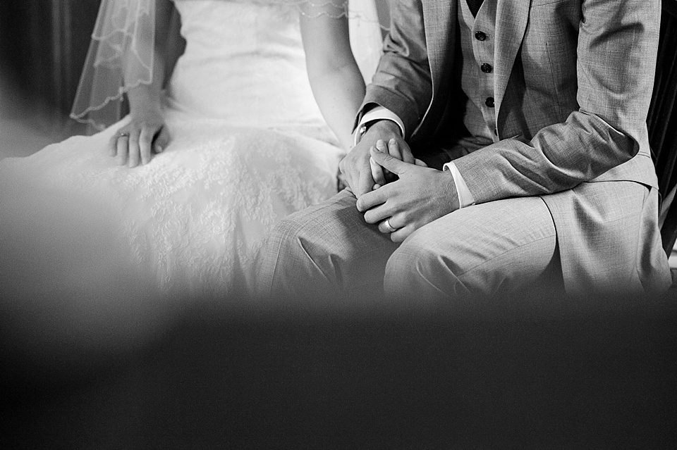 Bride and groom hold hands - English country garden wedding All Hallows Church Woolbeding Sussex - natural wedding photographer © Fiona Kelly photography