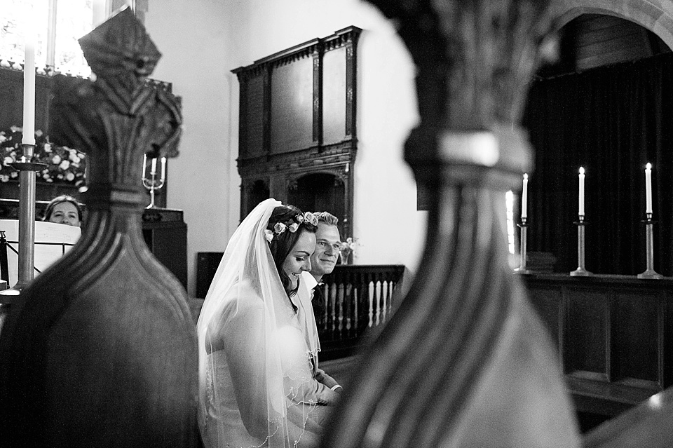 Sweet moments during the ceremony - English country garden wedding All Hallows Church Woolbeding Sussex - natural wedding photographer © Fiona Kelly photography