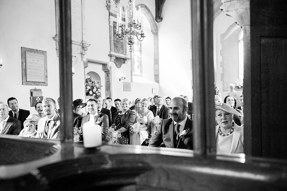 Wedding guests watching the ceremony - English country garden wedding All Hallows Church Woolbeding Sussex - natural wedding photographer © Fiona Kelly photography