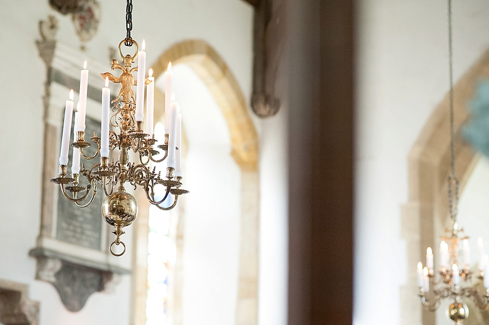 Beautiful chandelier at All Hallows Church Woolbeding Sussex - natural wedding photographer © Fiona Kelly photography