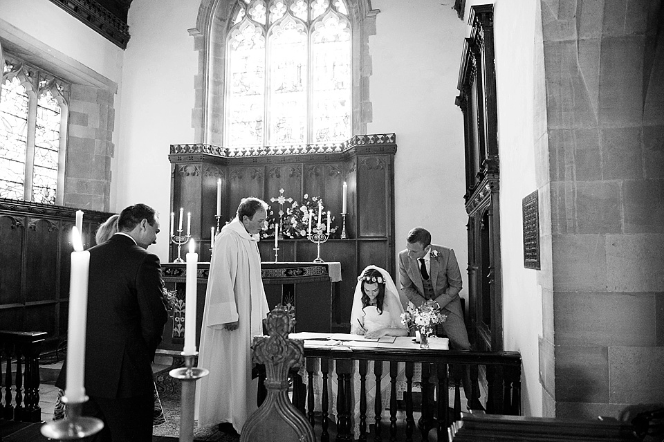 Signing the register at English country garden wedding All Hallows Church Woolbeding Sussex - natural wedding photographer © Fiona Kelly photography