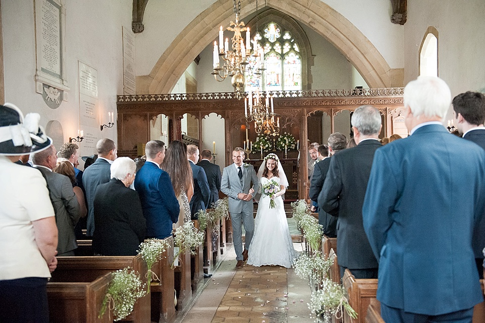 Bride and groom walk down the aisle together - English country garden wedding All Hallows Church Woolbeding Sussex - natural wedding photographer © Fiona Kelly photography