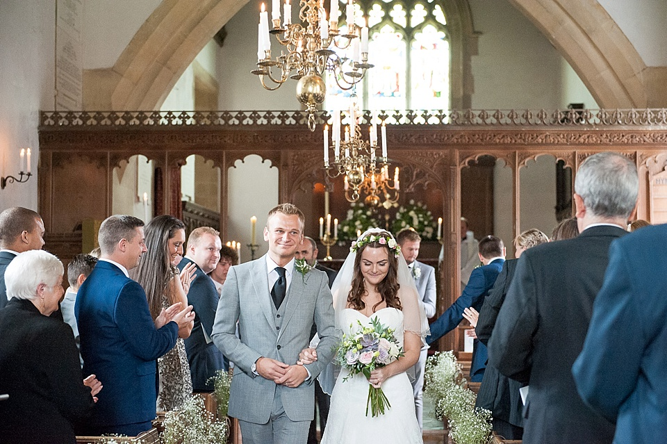 Happily married - church decorated with gysophilia by Blooms - English country garden wedding All Hallows Church Woolbeding Sussex - natural wedding photographer © Fiona Kelly photography