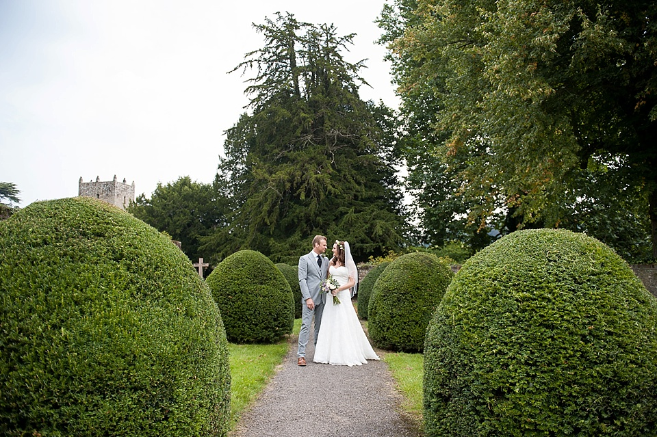 Wedding portrait in beautiful garden at English country garden wedding All Hallows Church Woolbeding Sussex - natural wedding photographer © Fiona Kelly photography