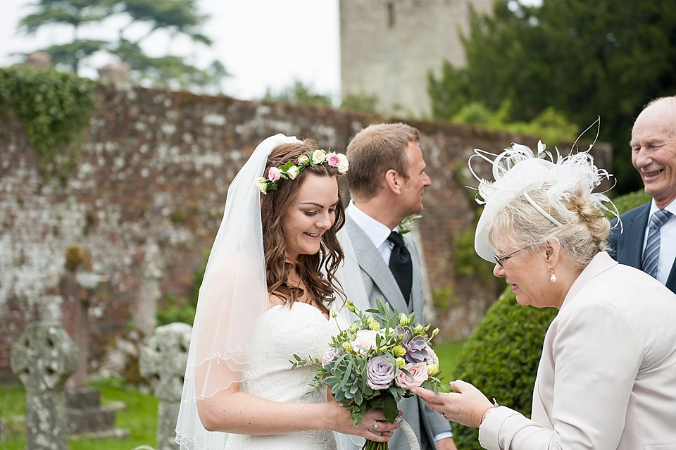 Bride with real flower crown and pink and green bouquet - English country garden wedding All Hallows Church Woolbeding Sussex - natural wedding photographer © Fiona Kelly photography