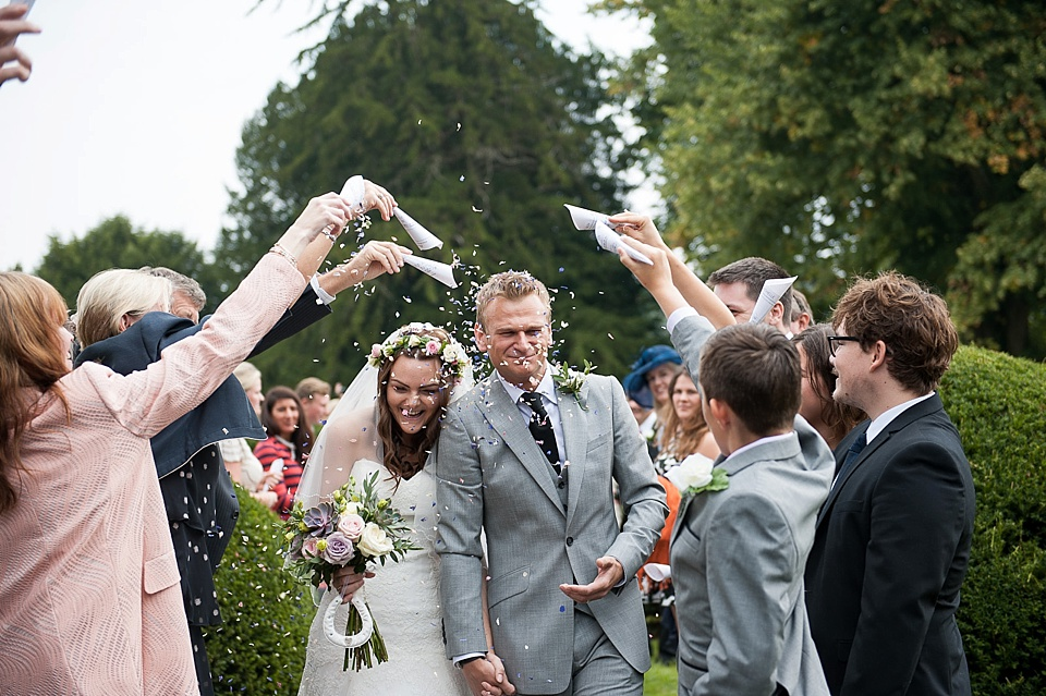 Lots of confetti at English country garden wedding All Hallows Church Woolbeding Sussex - natural wedding photographer © Fiona Kelly photography
