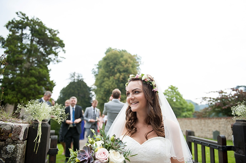 Bride with real flower crown, veil and flowers by Blooms - English country garden wedding All Hallows Church Woolbeding Sussex - natural wedding photographer © Fiona Kelly photography