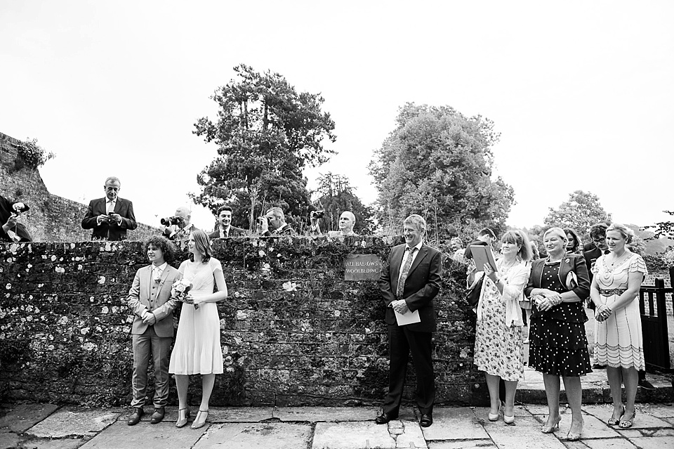 Black and white wedding guests English country garden wedding All Hallows Church Woolbeding Sussex - natural wedding photographer © Fiona Kelly photography