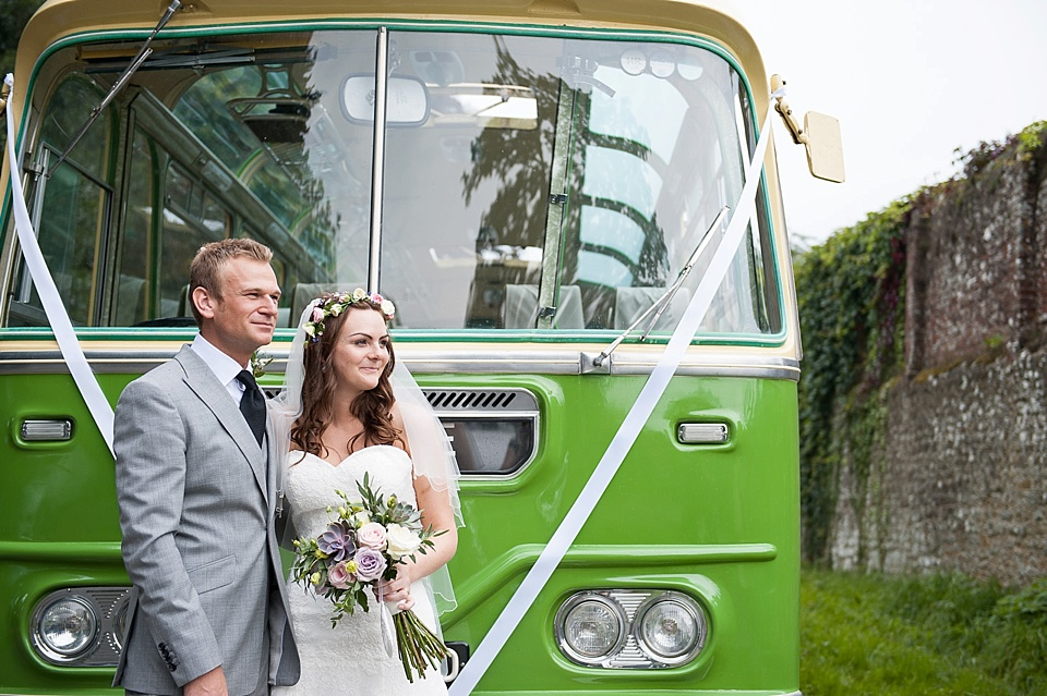Bride and groom next to vintage green bus a la Audrey Hepburn chocolate advert English country garden wedding All Hallows Church Woolbeding Sussex - natural wedding photographer © Fiona Kelly photography