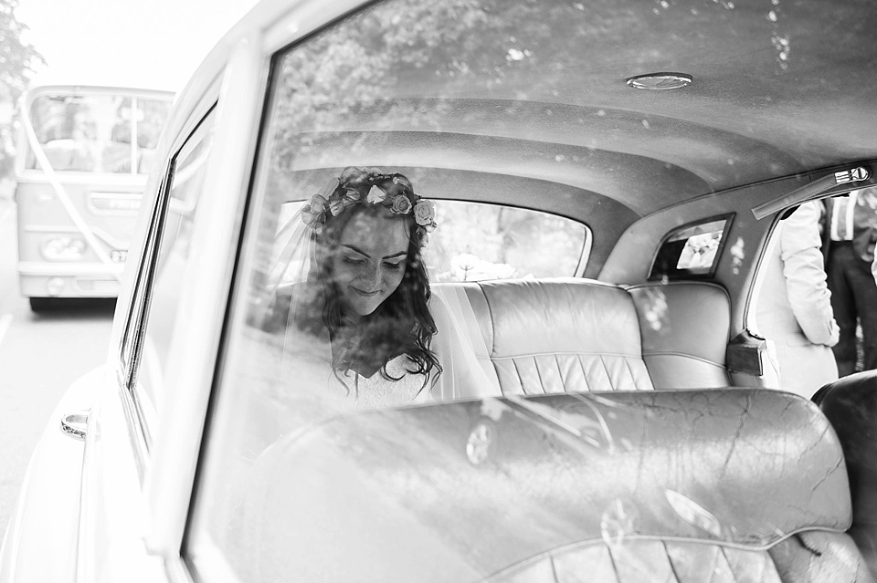 Bride in vintage white car - English country garden wedding All Hallows Church Woolbeding Sussex - natural wedding photographer © Fiona Kelly photography