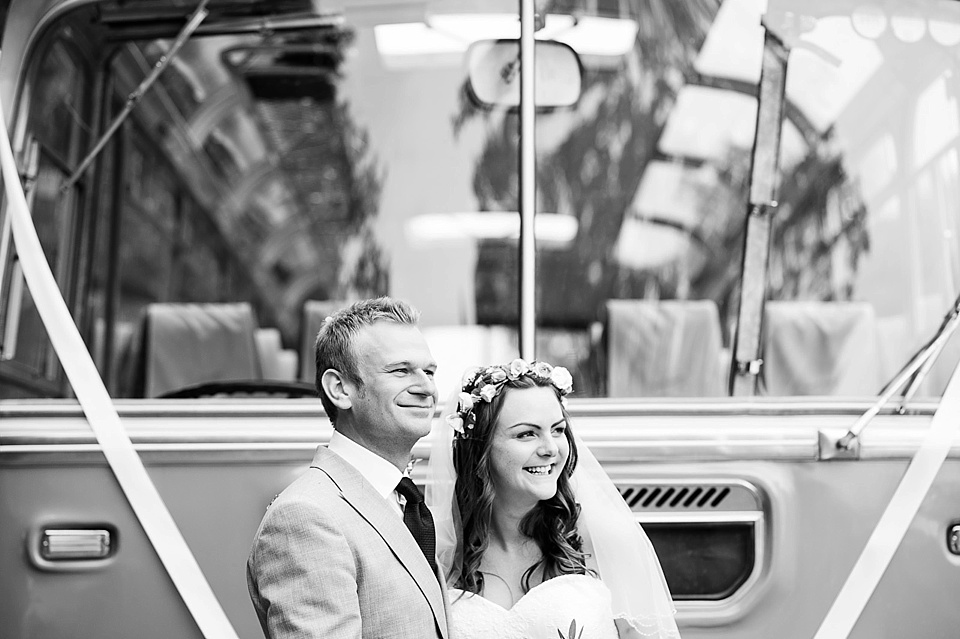 Black and white wedding portrait in front of vintage bus - English country garden wedding All Hallows Church Woolbeding Sussex - natural wedding photographer © Fiona Kelly photography