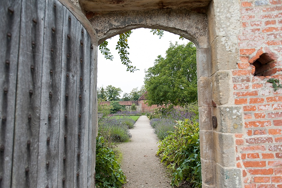Doorway leading to gardens at the Walled Garden in Cowdray - Sussex wedding photographer © Fiona Kelly photography