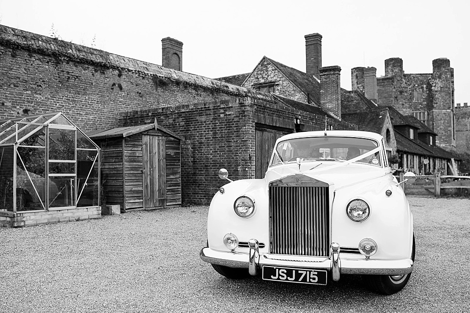 Vintage car from First Choice Cars arriving at English country garden wedding at the Walled Garden at Cowdray - Sussex wedding photographer © Fiona Kelly photography