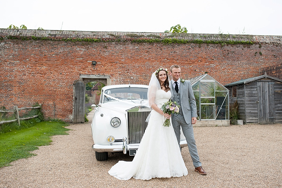 Wedding portrait in front of vintage white car at English country garden wedding at the Walled Garden at Cowdray - Sussex wedding photographer © Fiona Kelly photography