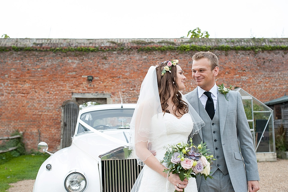 Bride and Groom with elegant vintage car at the Walled Garden at Cowdray - Sussex wedding photographer © Fiona Kelly photography