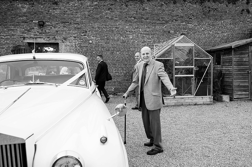 Vintage car and family at an English country garden wedding at the Walled Garden at Cowdray - Sussex wedding photographer © Fiona Kelly photography