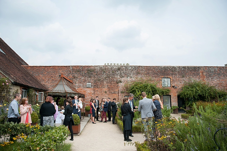 Guests outside in the garden at the Walled Garden at Cowdray - Sussex wedding photographer © Fiona Kelly photography