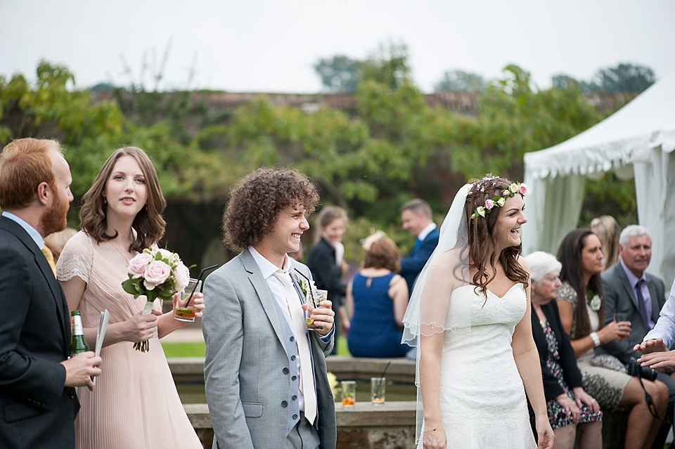 Bride and guests at an English country garden wedding at the Walled Garden at Cowdray - Sussex wedding photographer © Fiona Kelly photography