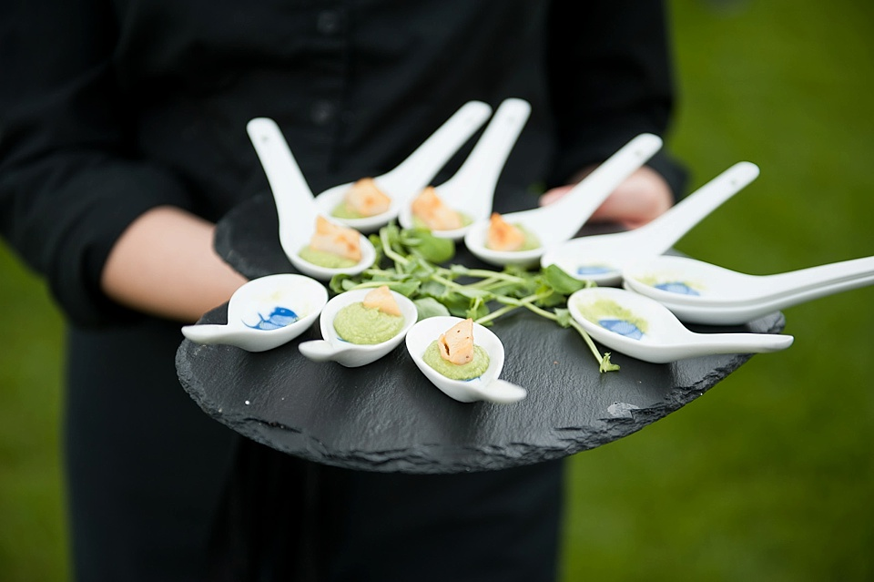 Chinese soup spoon with appetiser at an English country garden wedding at the Walled Garden at Cowdray - Sussex wedding photographer © Fiona Kelly photography